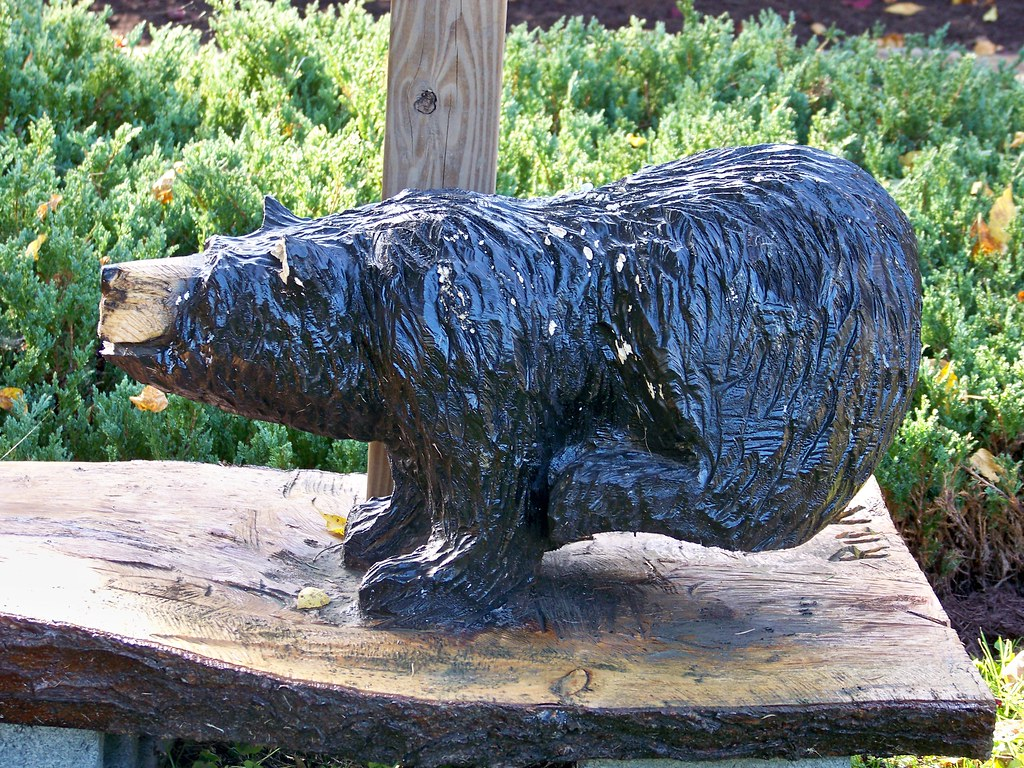 Bear chainsaw sculpture of a courtesy rick s