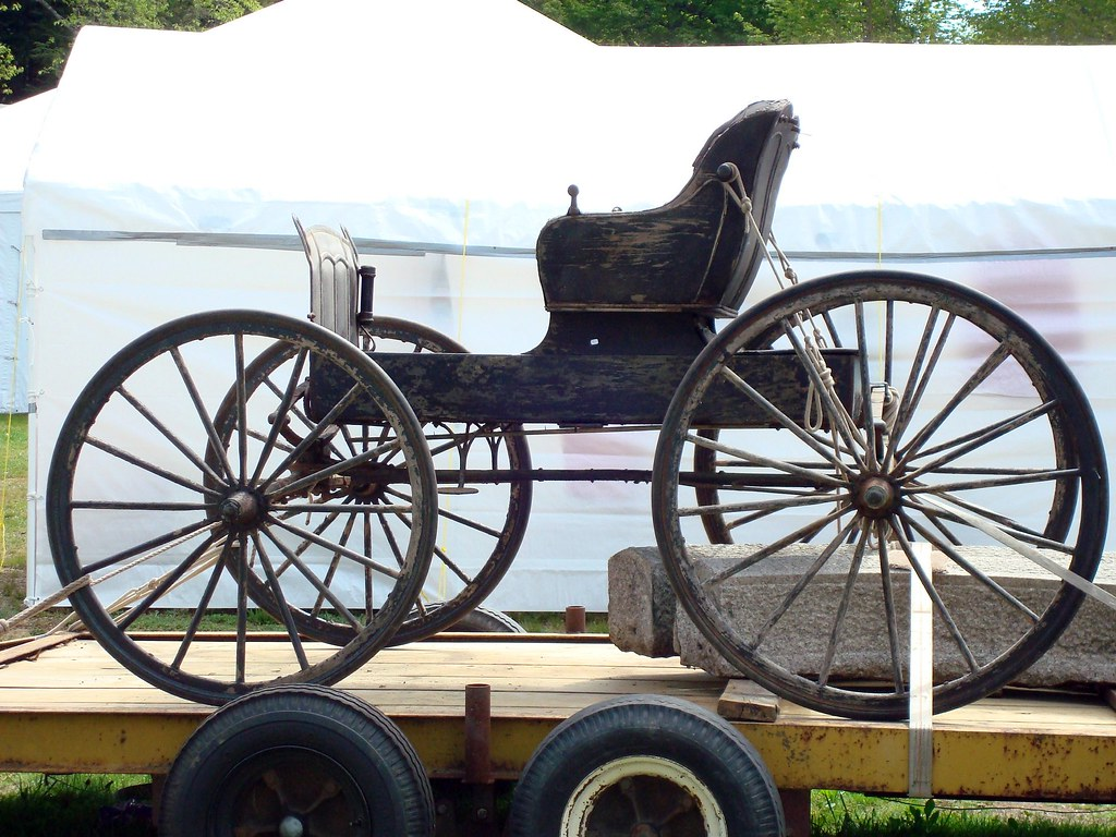 Buggy an old horse buggy for sale at the brimfield fair for Vintage horseshoes for sale