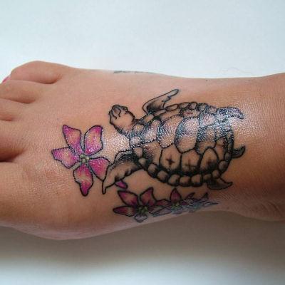 Hawaiian sea turtle with a hibiscus flower.   Yelp ...