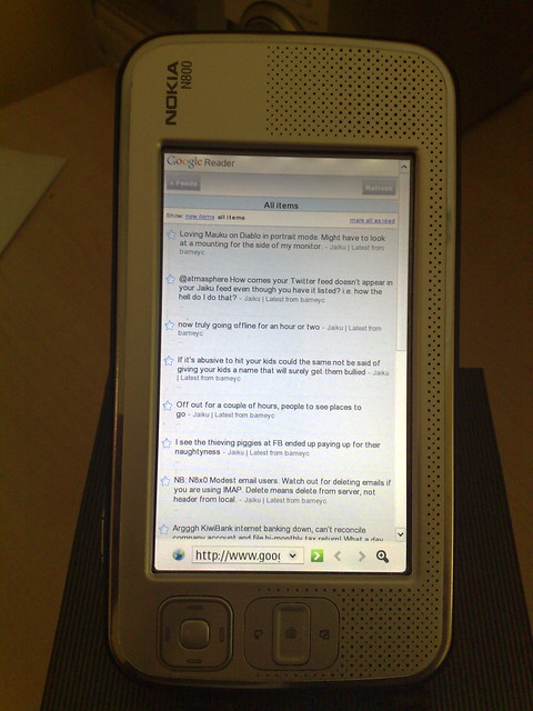 Nokia N800 (Diablo) running gReader iPhone on rotated ...