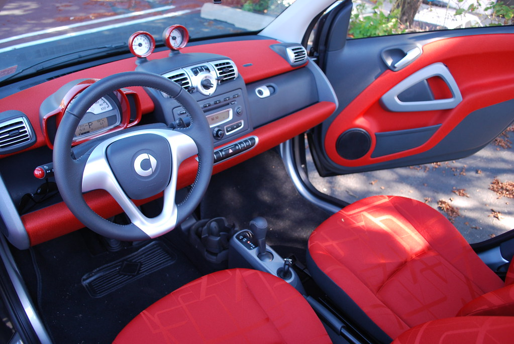 smart car interior small car big interior in screaming red whipix flickr. Black Bedroom Furniture Sets. Home Design Ideas