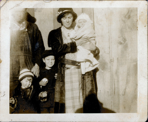 Man and woman with baby and two children