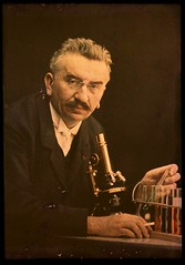 Louis Lumiere with microscope and test tubes | by George Eastman House