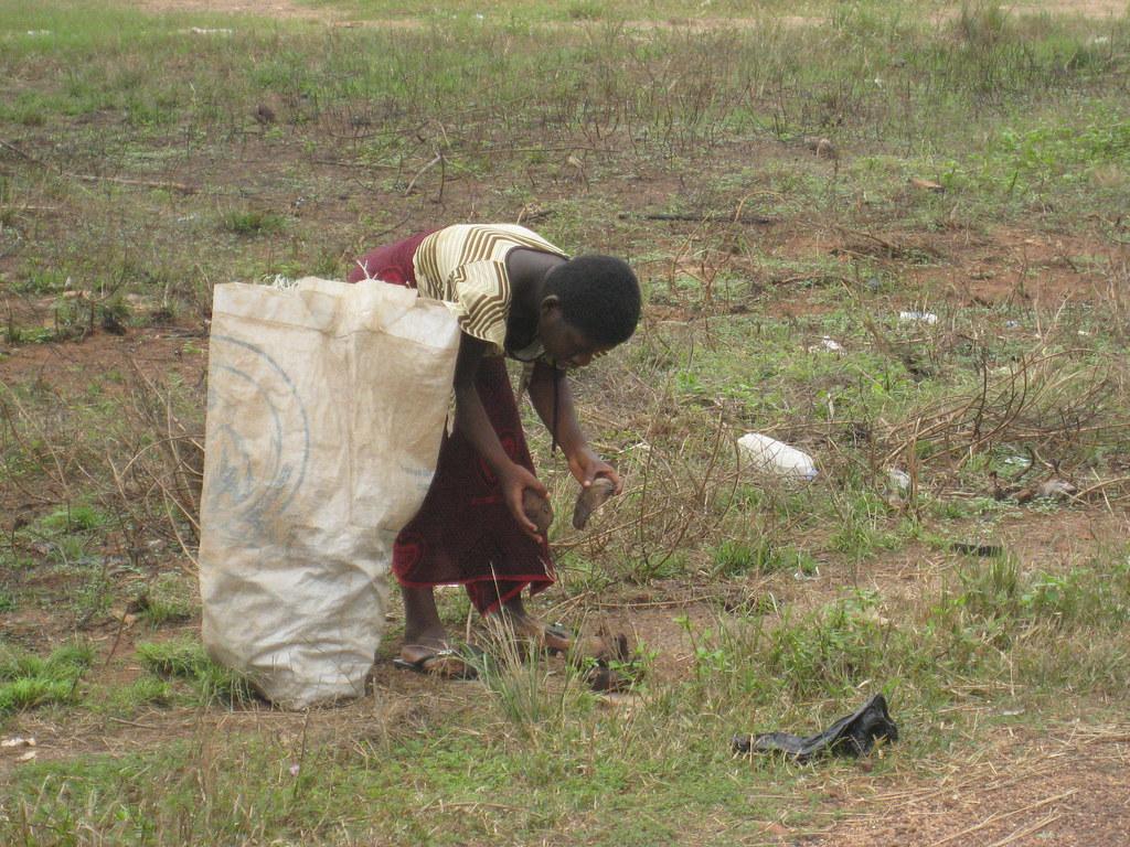 Outside the basilica - Yamoussoukro, Ivory Coast | A woman c ...