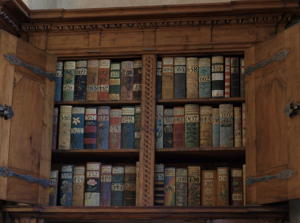 Old Bookshelf Full Of Books With Beautiful Book Covers