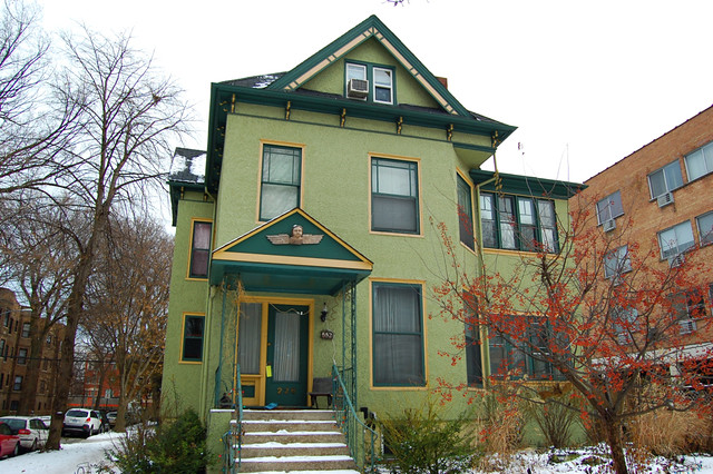 stucco Queen Anne | Green stucco Queen Anne-style house