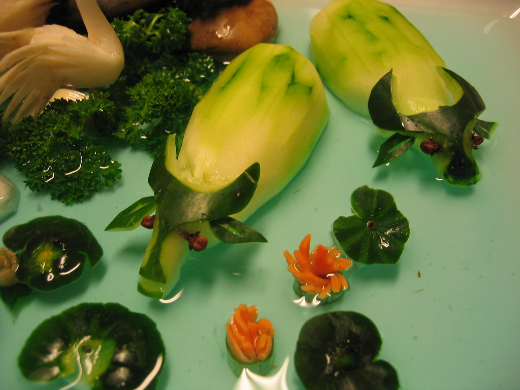 Vegetable carving these water buffalo are swrimping in a