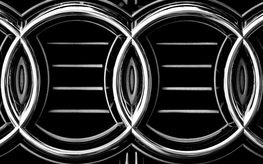 audi logo in black and white black and white photo of