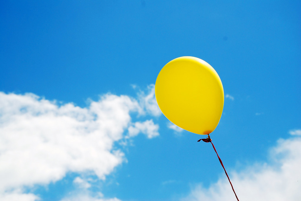 Balloon in a Summer Sky | A photograph of a brightly ...