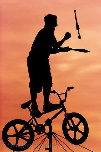 Busker on tightrope with bicycle silhouette | by Sheila Smart Photography