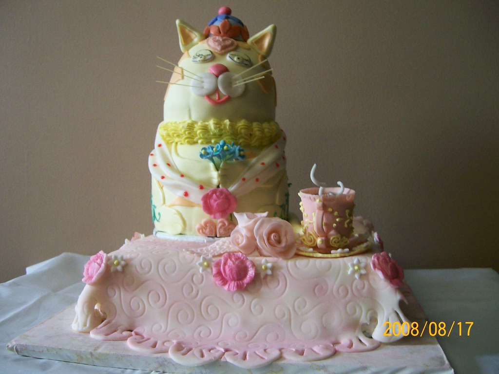 Mrs Cat sitting on the table with a tea cup  Birthday cake ...