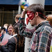 Mask and Coffee Can Rattle at the Bailout Protest