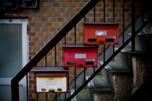 mailboxes on stairway of apartment building waseda