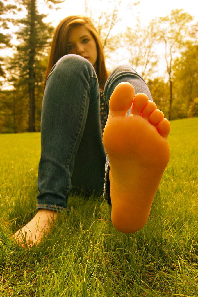 Girl Shows Shoes And Feet