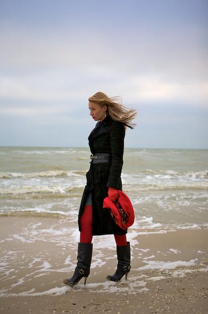 Blonde Girl Walking On Sea