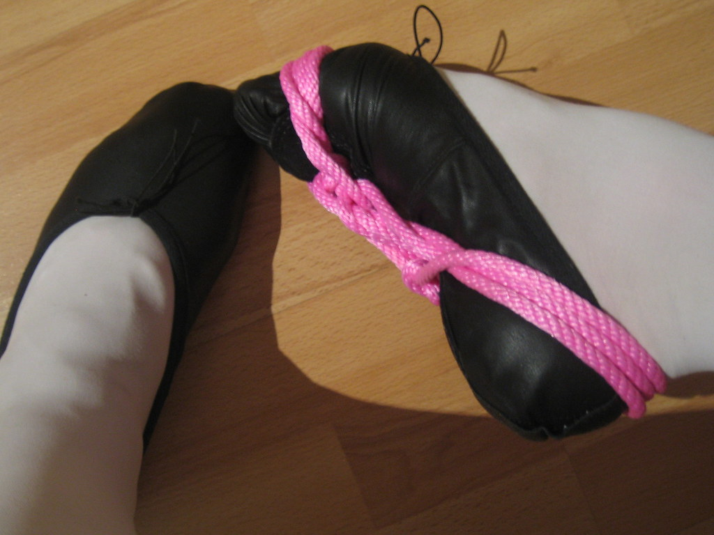 Close-up of children 2019s ballet slippers and feet
