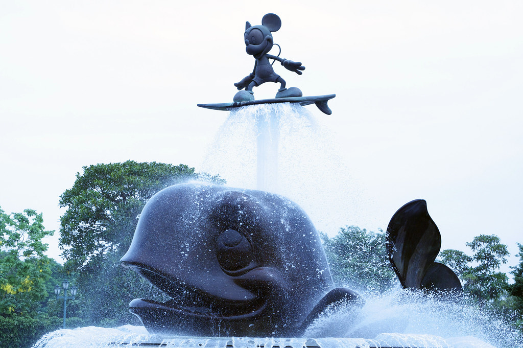 mickey mouse surfer statue mickey mouse surfing a whale