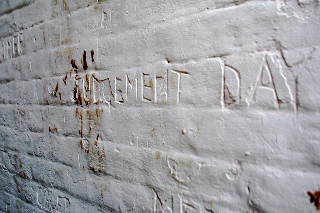 Img g creeeeeepy writing carved into a small