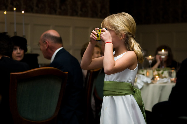 child photographing a wedding