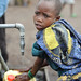 Collecting water with a Kabila pagne