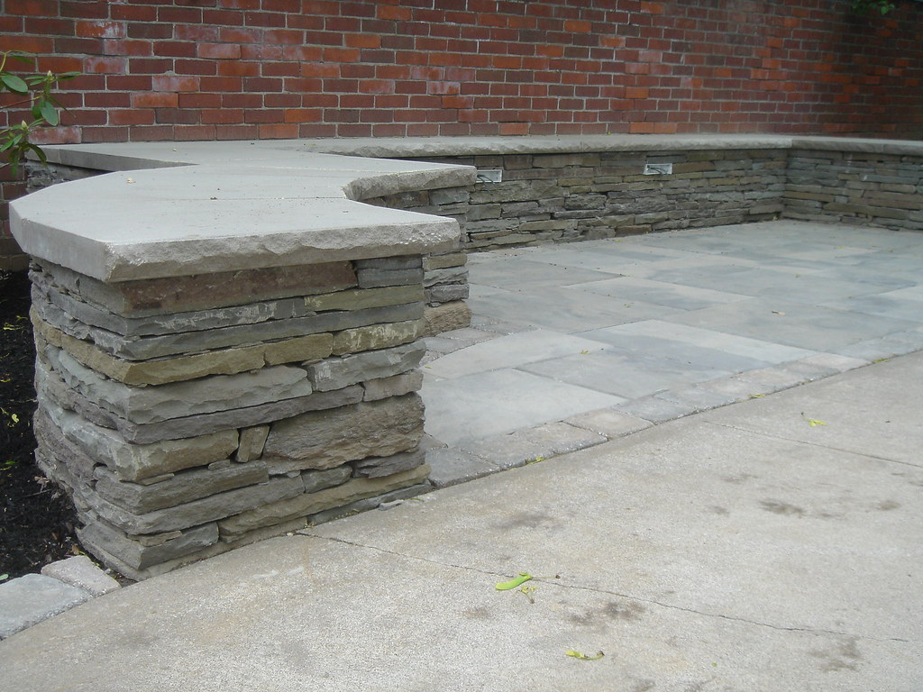 Natural Stone Wall Caps : Limestone slabs cap these natural stone seating walls the