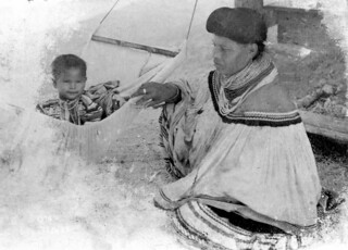 Miccosukee mother rocks her baby in a hammock | by State Library and Archives of Florida