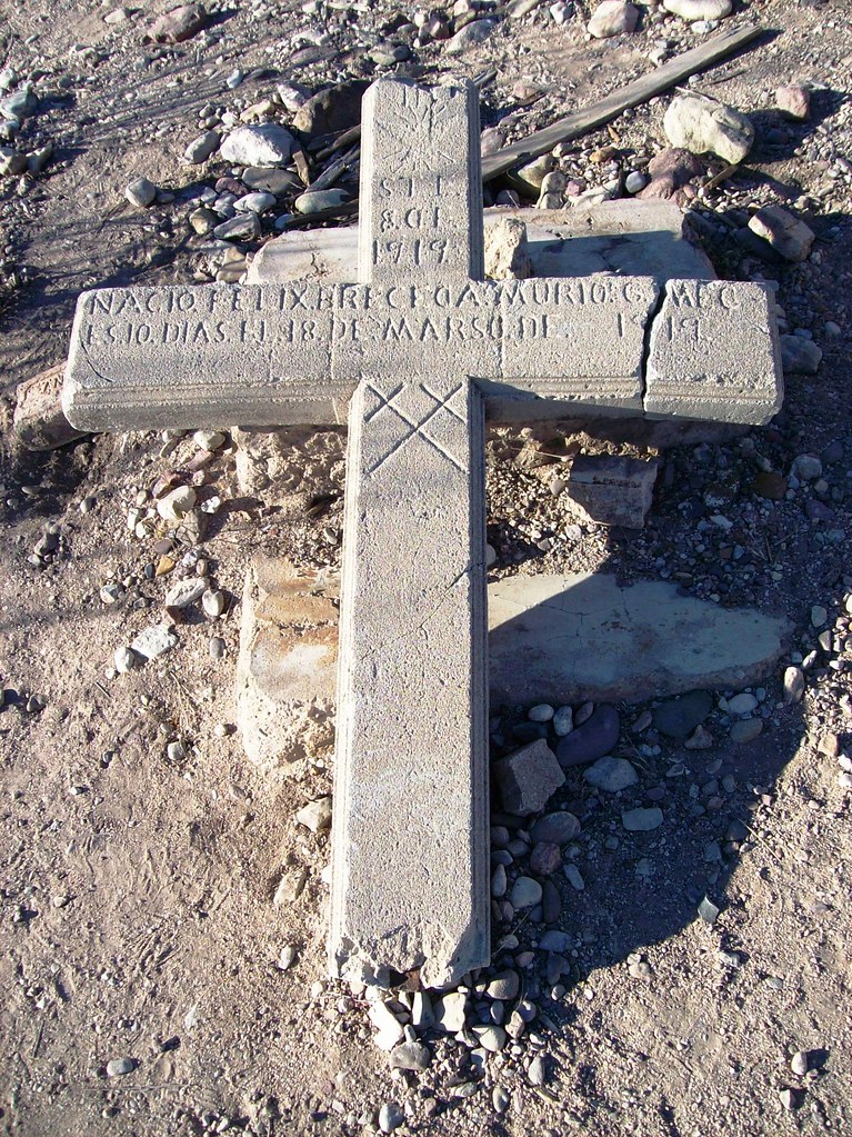 Cross Shaped Tombstone On The Hill Outside The Ghost Town