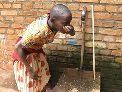 Girl Drinking Water in Rwanda | by Jon Gos