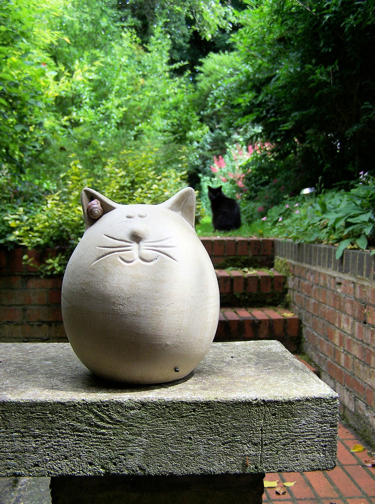 Two Fat Cats One Made Of Stone With A Rather Fetching Ear Flickr