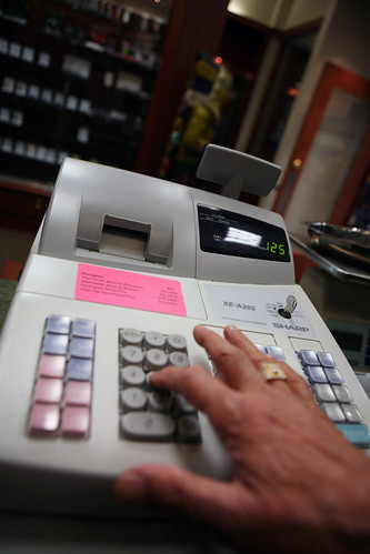 cash register hand - stock | by WNPR - Connecticut Public Radio