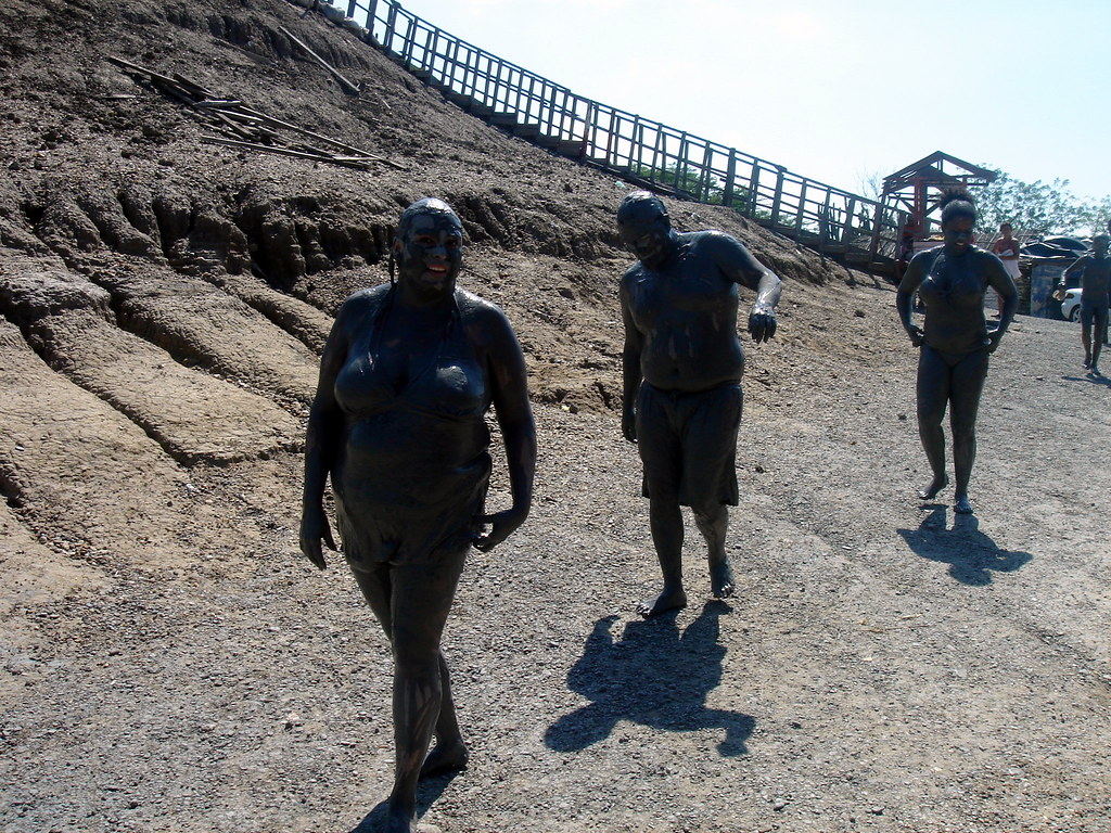 the mud people   Aty, Ruben and Rhea all covered in mud ...