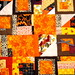 Close-up detail of a scrappy Halloween quilt