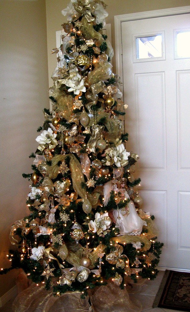 Magnolia inspired christmas tree adorning trees for the for White silver and gold christmas tree
