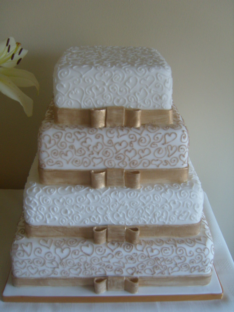 square 4 tier wedding cakes 4 tier square wedding cake with lace pipework and bows 20343