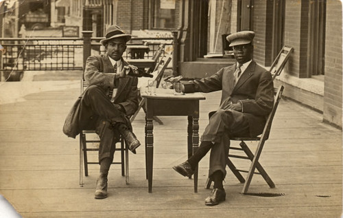 African American Men Sitting Around Table
