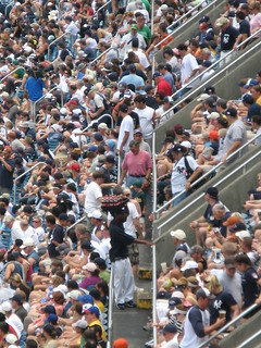 Looking directly along the Tier level aisle on the first base side at Yankee Stadium, 7/19/08 | by Gary Dunaier