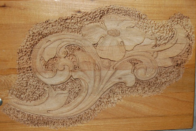Acanthus pattern carved in shallow relief on wood an