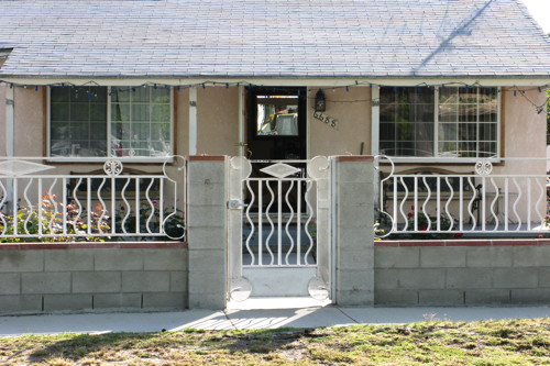 Backlight Wrought Iron Gate And House Front With Door Open