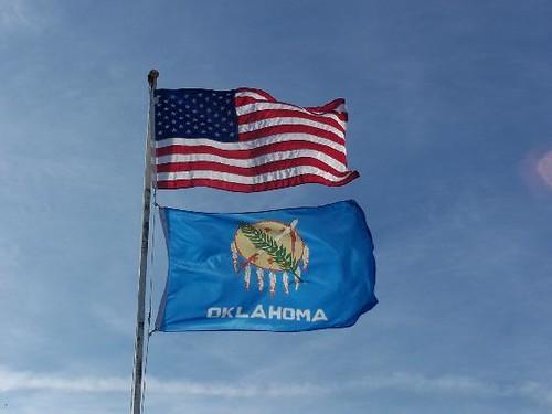 Oklahoma State Flag Beneath The American Flag The