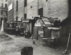 Huts and unemployed, West Houston and Mercer St., Manhattan. | by New York Public Library
