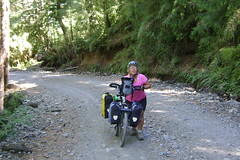 DSC03114 Nancy pushing her bike up to the Chilean border at Paso V. Peres Rosales