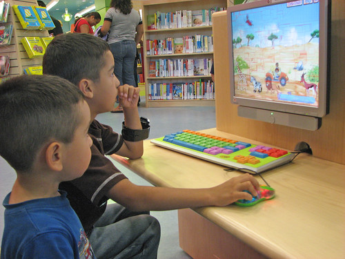 Children using the computer. | by San José Library