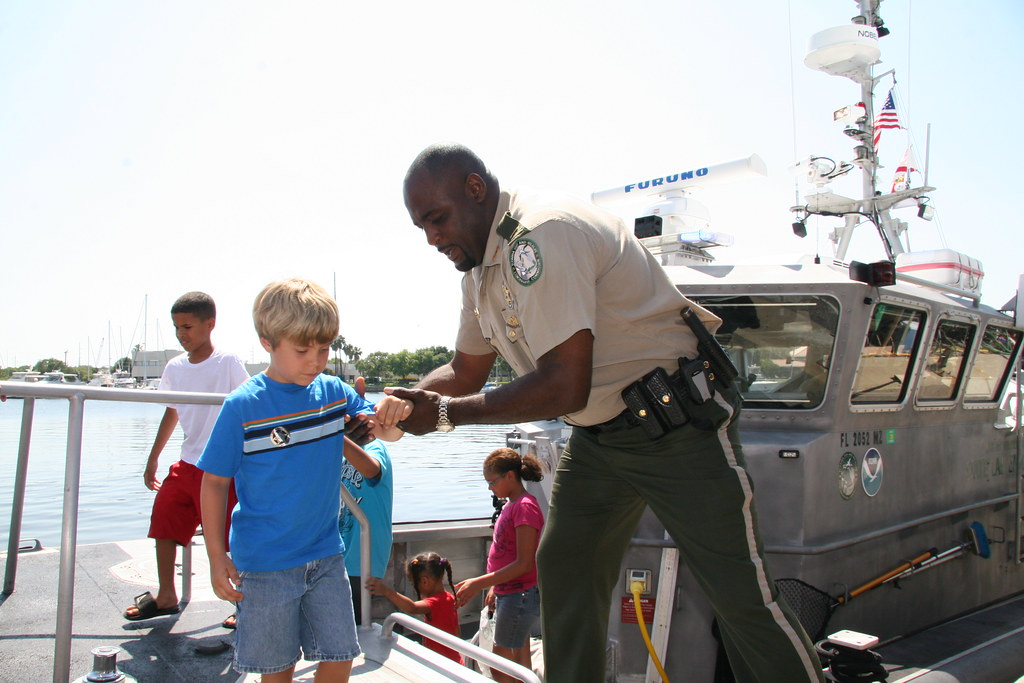 Fwc law enforcement an officer helps visitors disembark for Florida fish and wildlife officer