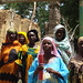 Central African women inspecting building for microfinance project