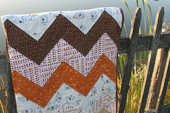 zig zag quilt, folded on a fence | by filminthefridge