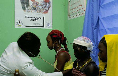 Doctor examines patients | by World Bank Photo Collection
