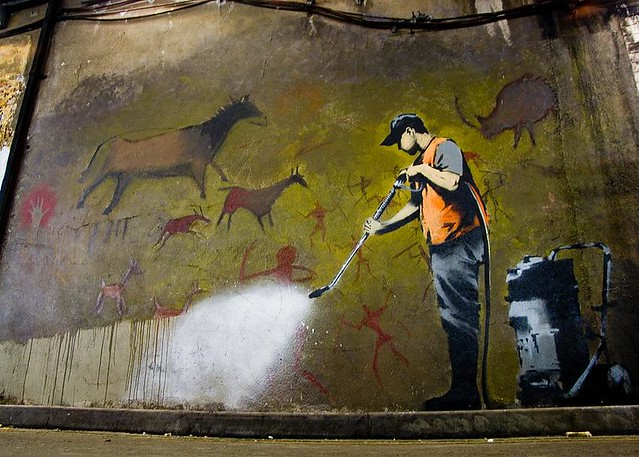 banksy  council worker cleaning up the cave paintings