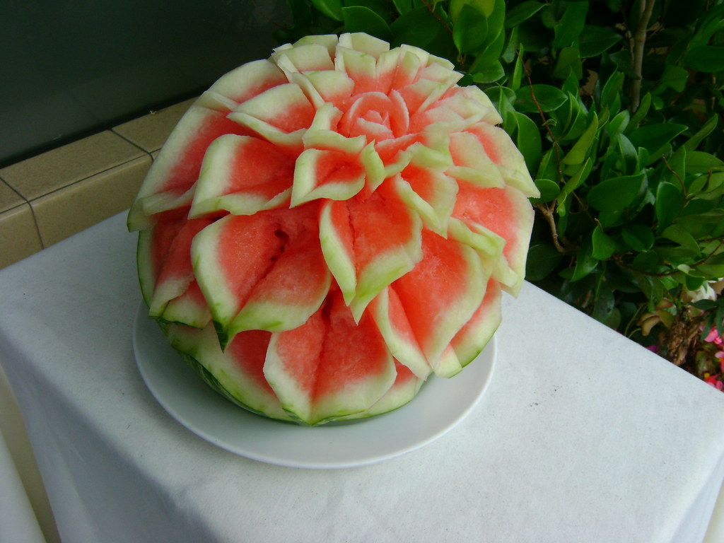 Watermelon sculpture carved out of and placed