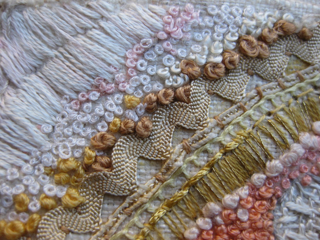 Embroidery stitches looking at the surface of a shell