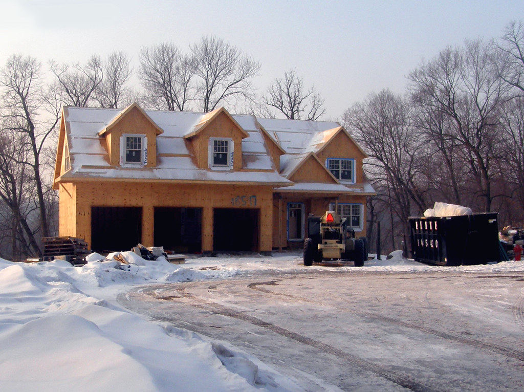 A 3 Car Garage With House Attached Being Built In A
